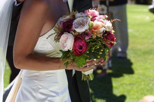 pink, peach callas, light pink, hot pink english garden roses, orange vanda orchids,hypericum and...