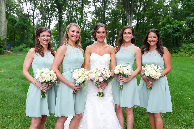 Bridesmaids group photo with the bride