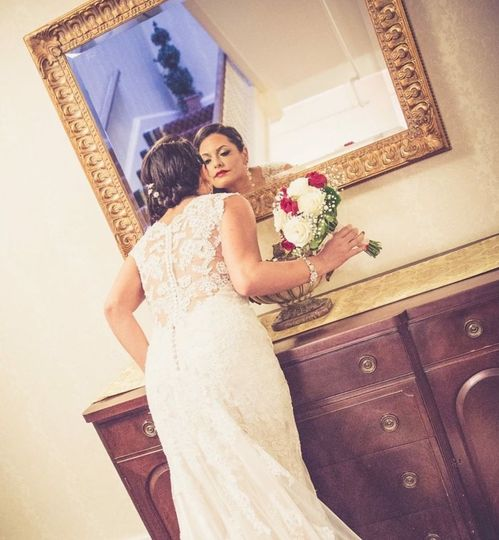 Bride looking at the mirror