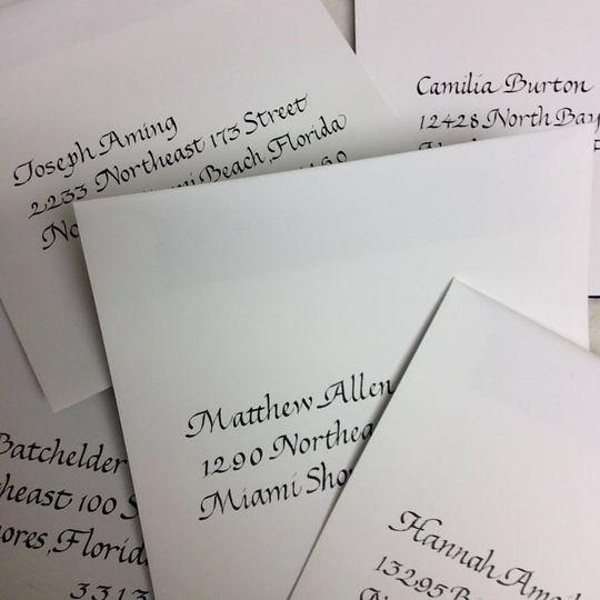Italic writing on oversized envelopes. #CalligraphybyElaine