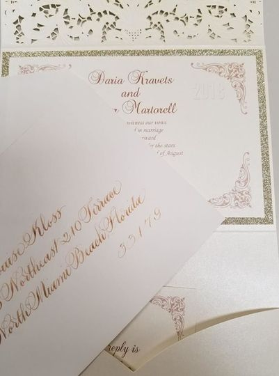 Calligraphy by Elaine Oversized envelopes addressed in Gold to match invite.