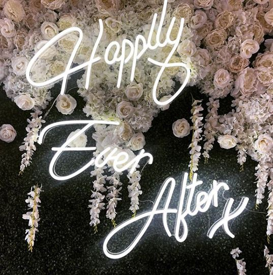 Happily Ever After in white neon