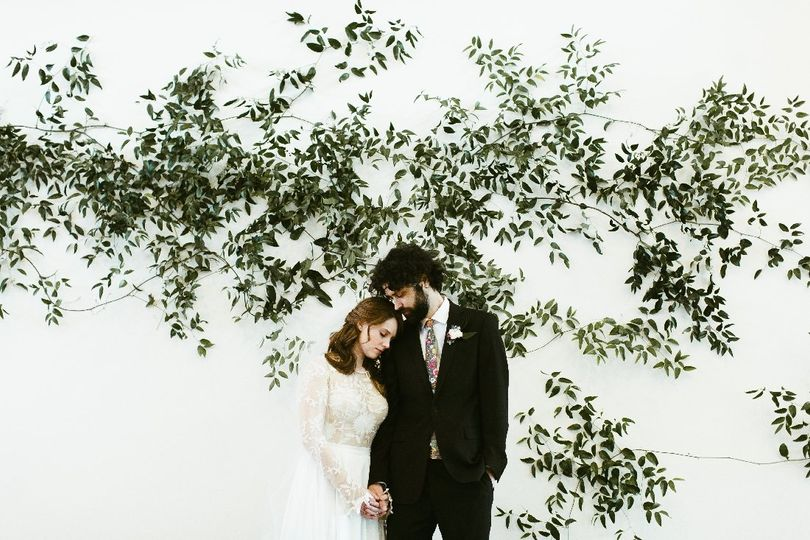 Bride and groom greenery