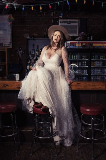 Bride seated on the bar
