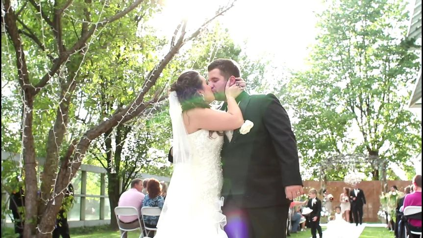 Chelsey and Steve share their first post-wedding kiss right at the end of the aisle!