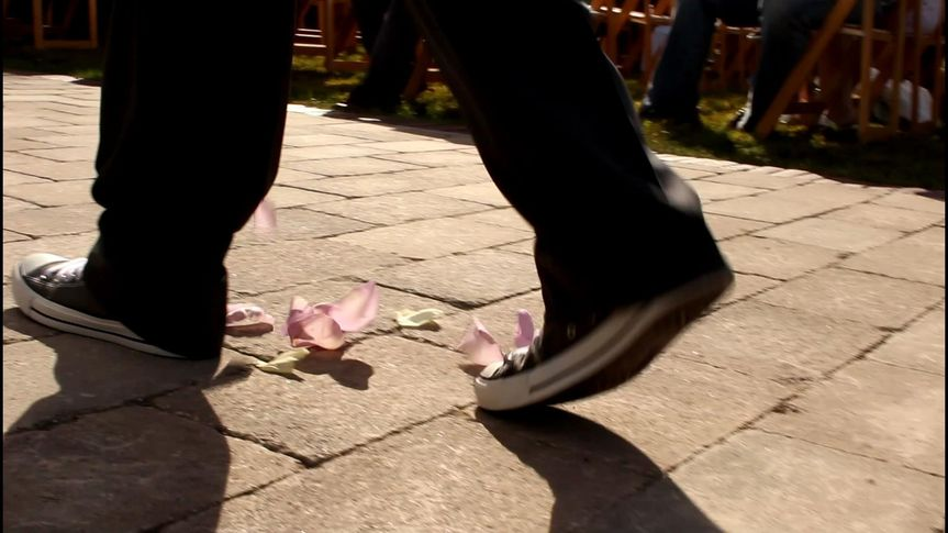 "Sarah and Justin has cool ""flower boys"" at the ceremony.  Look at those chucks!"