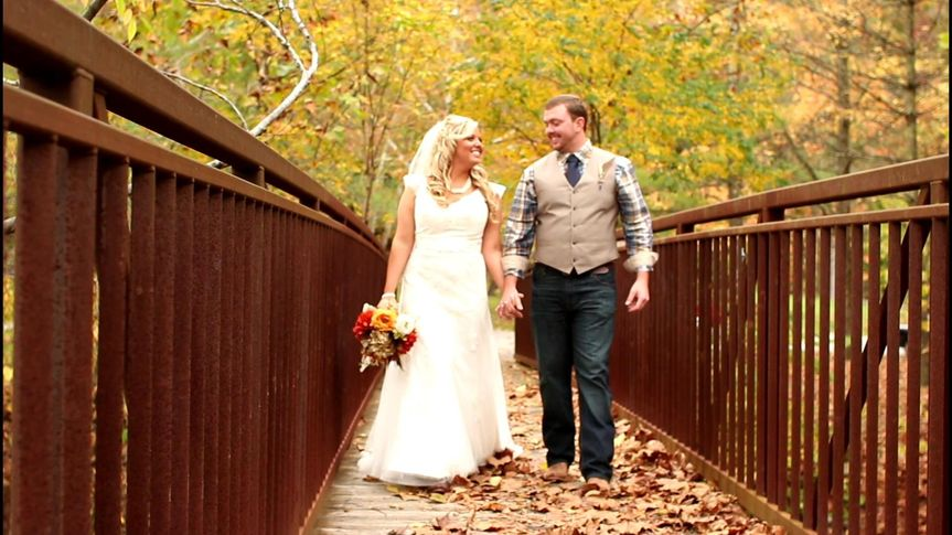 Leslie and Patrick walk hand in hand across the Lake Vesuvius bridge.