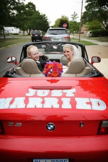 The couple on a red car