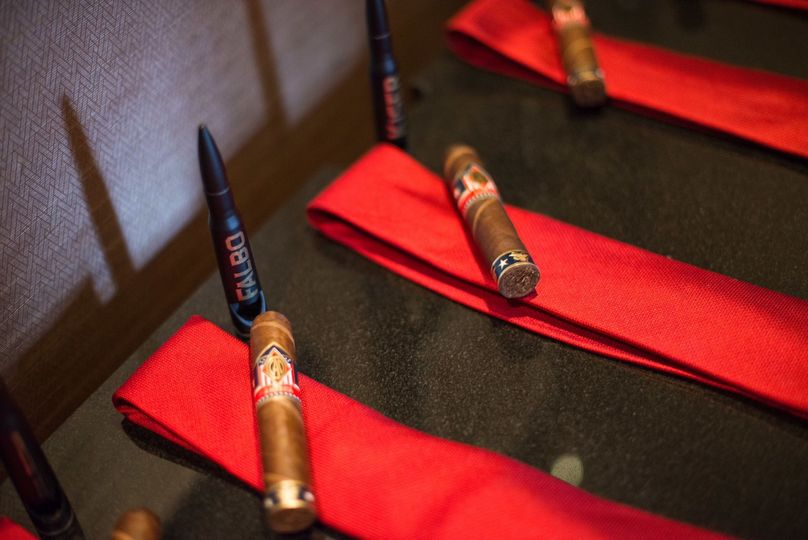 Our .50 Caliber Bottle Openers as part of the spread for groomsmen gifts