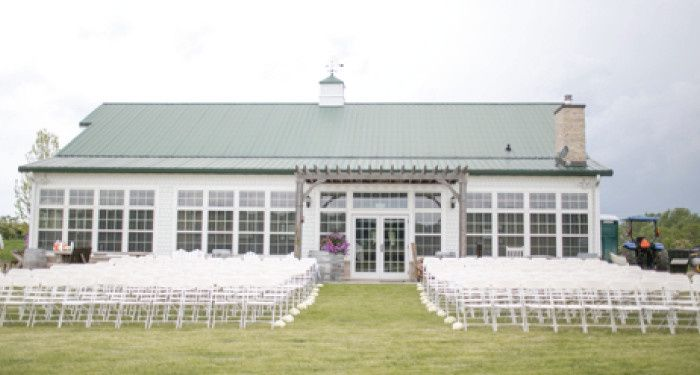 A beautiful back drop for the ceremony. One of three options for the location at the property of...