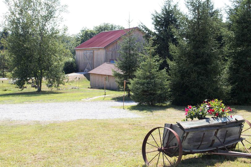 Barn, bunkhouse and antique spreader