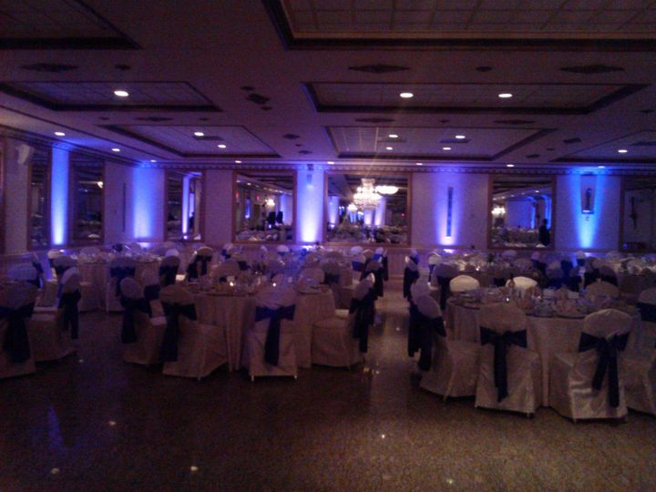 Gold Ballroom dressed up with Purple Uplighting and Purple Chair Sashes.