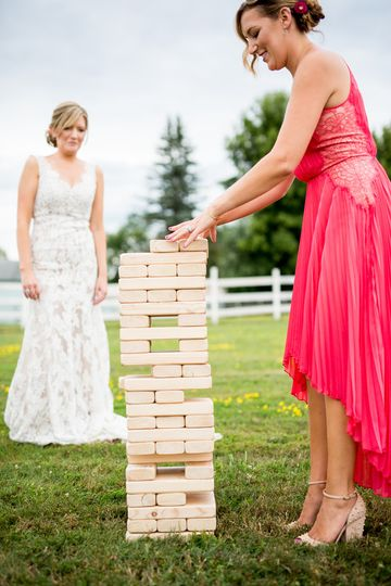 Bride playing with her bridesmaid