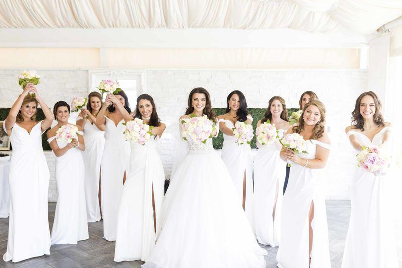Beautiful white floral elegant wedding.   Legacy of Love Premiere Wedding Photography...