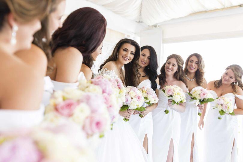 Beautiful white floral elegant Florida wedding.   Legacy of Love Premiere Wedding Photography...