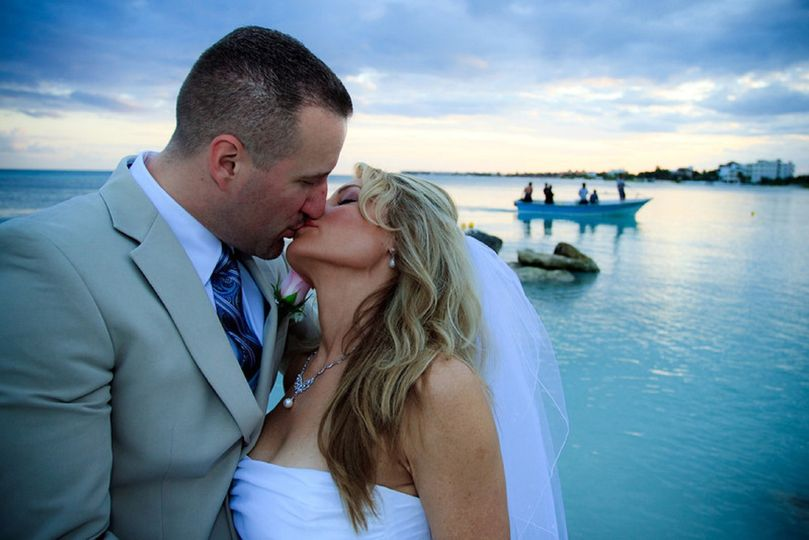 bride and groom blue kiss 2 resized