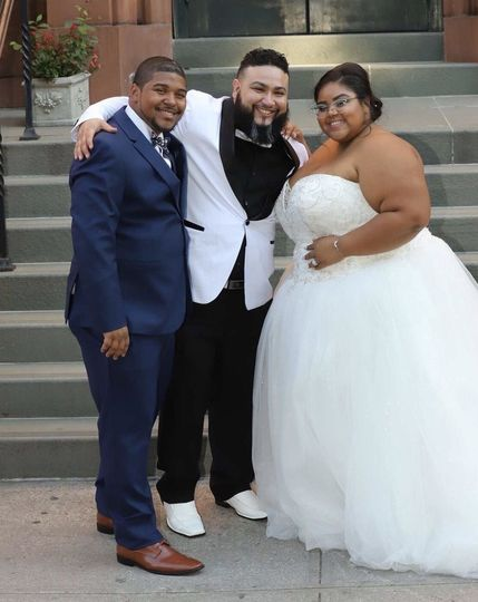 Posing with the newlyweds