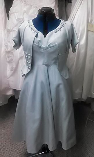This was a redesign of grandmas wedding suit from the 40's We made the dress bigger using the inside...