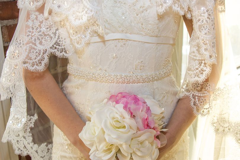 Lace details of the dress and veil