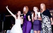The bride with her bridesmaids singing