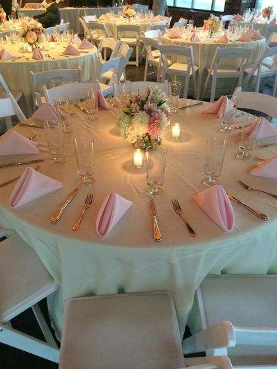 reception ivory linens pink napkins close up