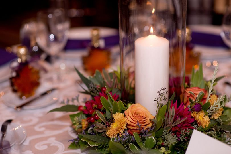 Candle and floral arrangement