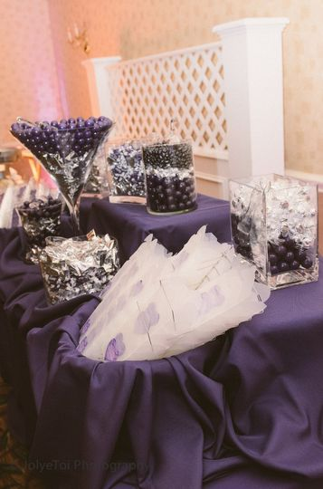Candy Station: Frosted take out boxes with bride & grooms personalized label added.