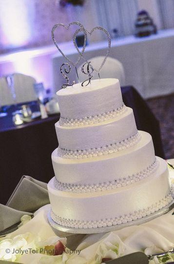 Larke-Adam wedding cake.  Silver Monogram cake topper.