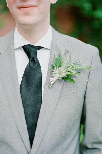 Grey suit with boutonniere and tie