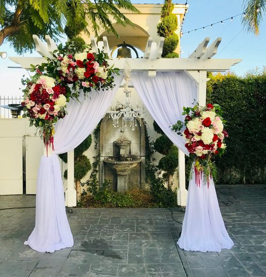 Ceremonial arch draping and fl