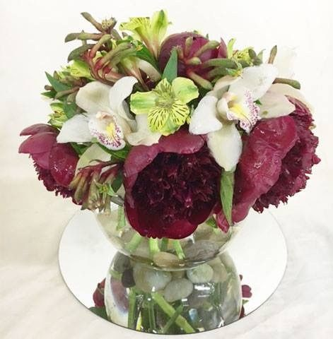 Maroon floral table centerpiece