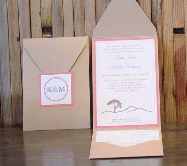 A classy pocketfold suite featuring a monogrammed tag that was carried throughout the event....