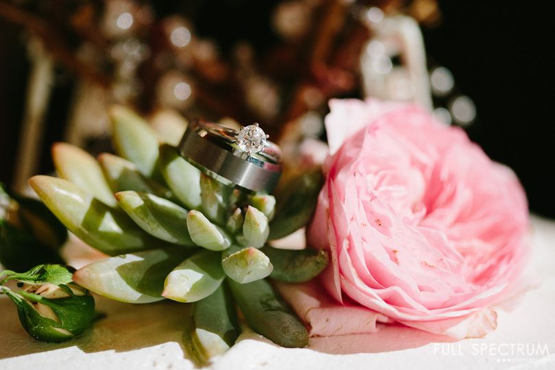 Creative portrait of the wedding ring on the flower