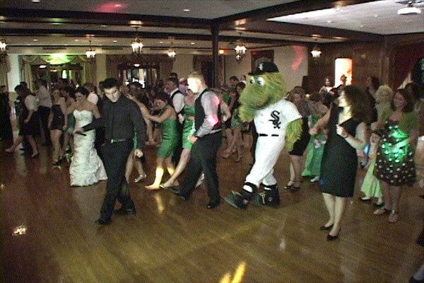 The couple dancing with guests
