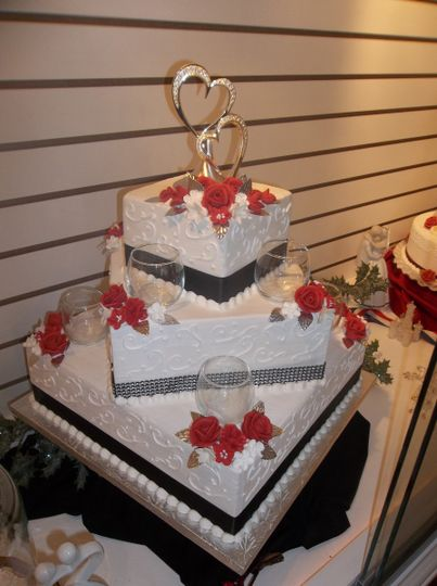 Three tier wedding cake with red flowers
