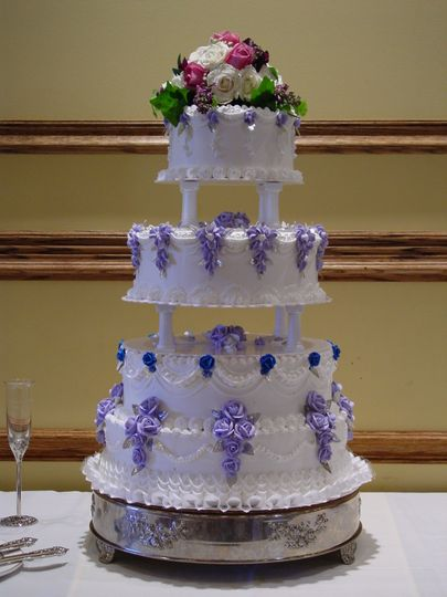 Four tier wedding cake with purple icing