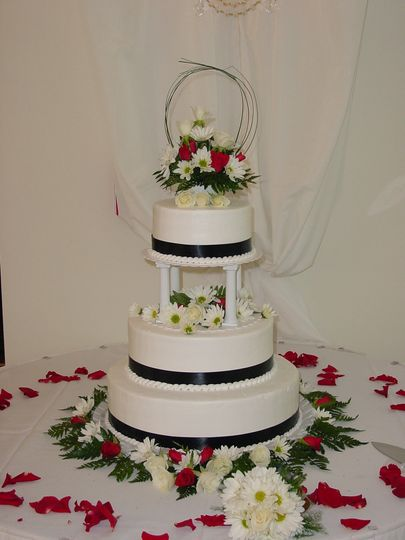 Three tier wedding cake with flowers on top