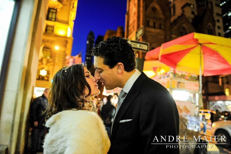 bride and groom kiss outside the St Regis Hotel NYC