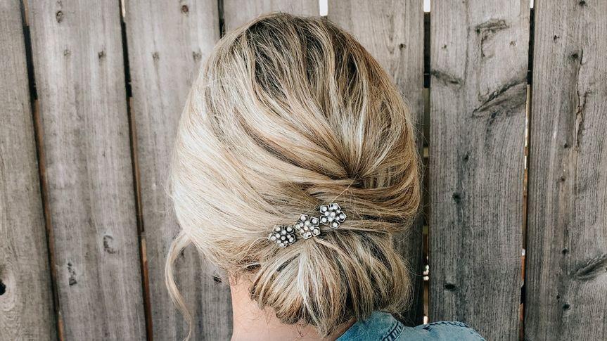 Sleek updo with hair piece
