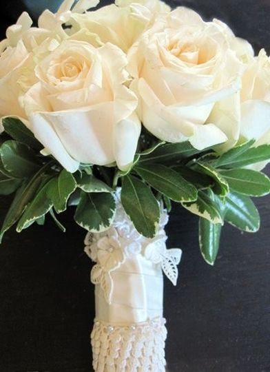 bridal bouquet wrapped with elements from the bri