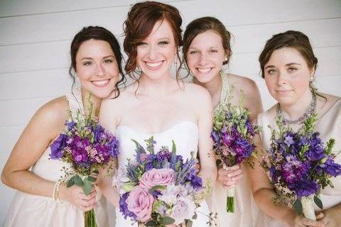 bride and bridesmaids purpl