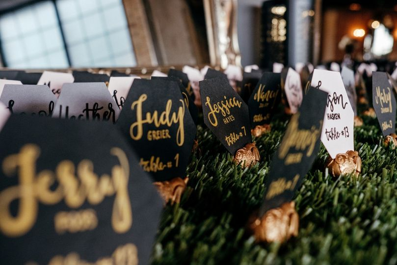 Place cards with black, gold, and white