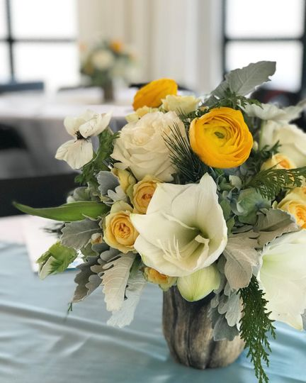 White and yellow floral centerpiece