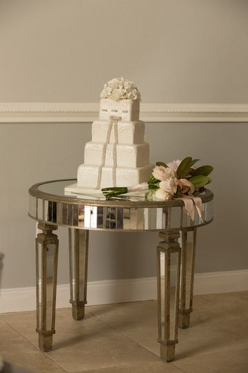 Beautiful wedding cake with a glam table.