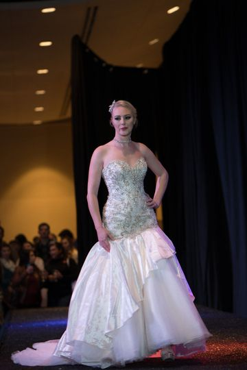 On the runway, Uptown Bride shows off it's styles of wedding gowns