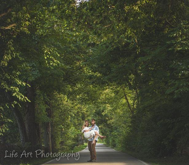 Lifting his bride