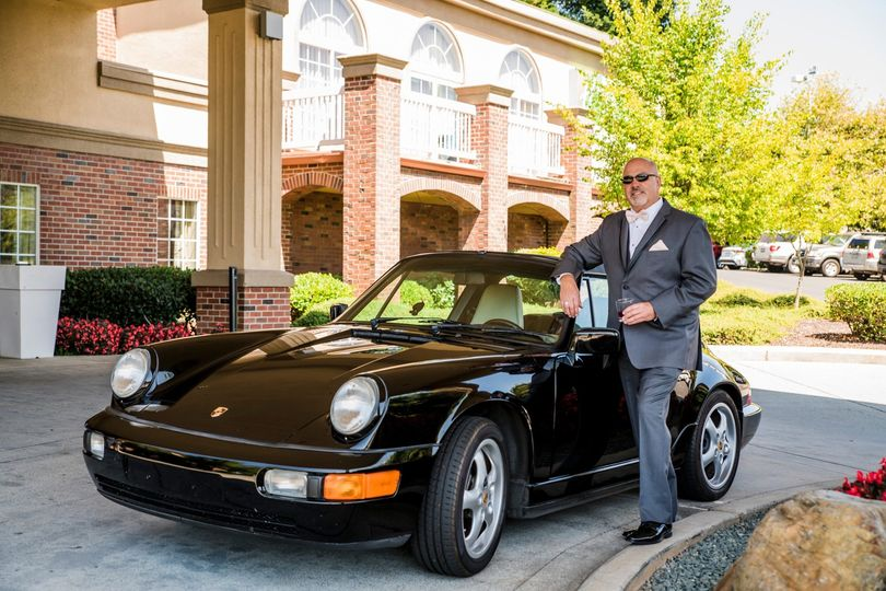 Groom with classic Porsche.