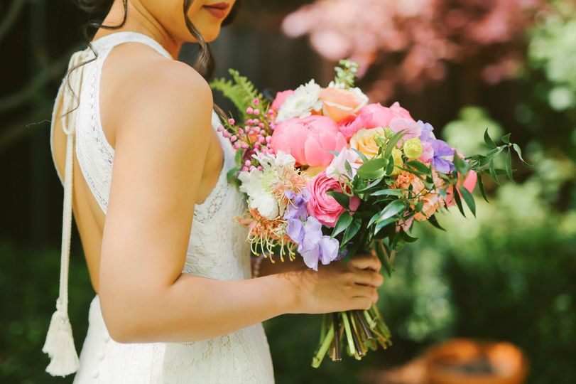 Close-up of bride and bouquet