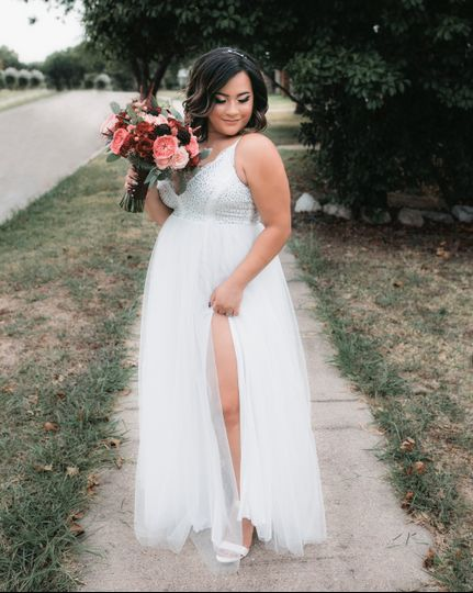 Bride with dress and bouquet
