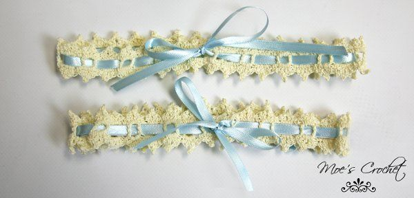 Ivory garter with light blu satin ribbon